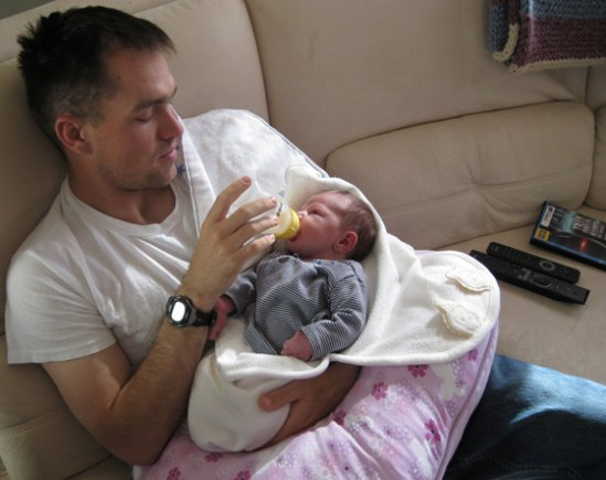 Former Staff Sgt. Clinton L. Romesha feeds his second daughter, Gwen. He deployed to Afghanistan in the spring of 2009, about five weeks after she was born. Just a few months later, he defended Combat Outpost Keating against about 300 enemy fighters...