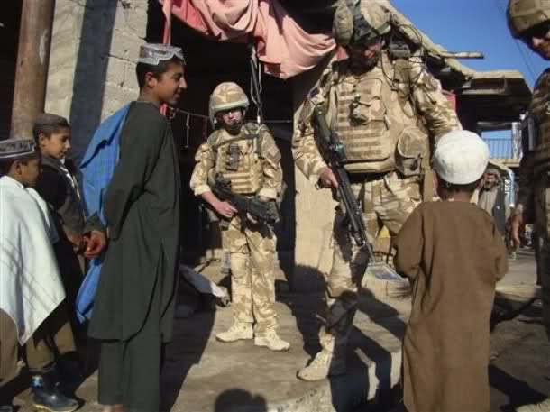 British soldiers with the NATO led- International Security Assistance Force (ISAF) are seen talking with an Afghan child while patrolling in Sangin district of Helmand province, south of Kabul, Afghanistan, Wednesday, Dec. 2, 2009. NATO Secretary-General Anders Fogh Rasmussen said he expects the allies to boost the NATO-led force by more than 5,000 soldiers. He said the best way to overcome widespread public opposition to the war in Europe is by demonstrating progress on the battlefield. (AP)