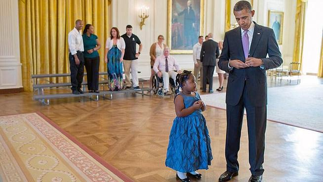 Official White House Photo by Pete Souza President Barack Obama writes a school excuse note for Alanah Poullard, 5, while visiting with Wounded Warriors and their families in the East Room during their tour of the White House, Sept. 19, 2013. Alanah asked for a note to show her kindergarten teacher.
