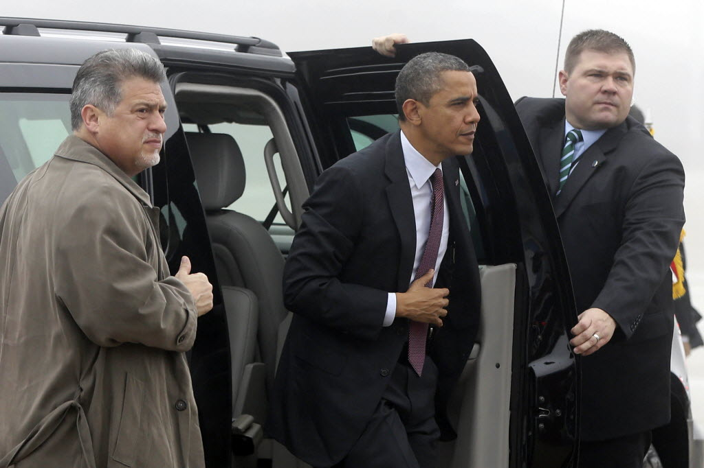 U.S. Secret Service agents open the door for President Barack Obama as he arrives at Joint Base Andrews for a flight to Michigan on Dec. 10, 2012.