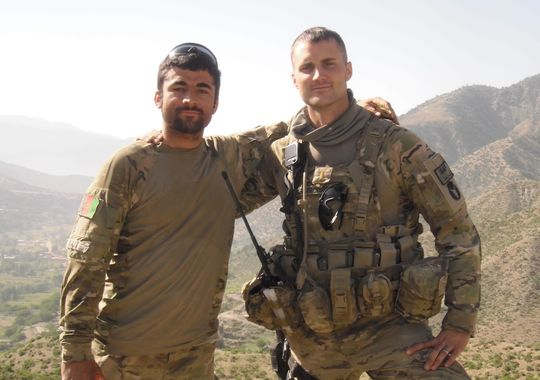 """Iowa National Guard Lt. Pat Hendrickson, right, stands with Nabiullah Mohammadi in Afghanistan. """"He was my right-hand man,"""" Hendrickson said.(Photo: Courtesy photo via The Des Moines Register)"""