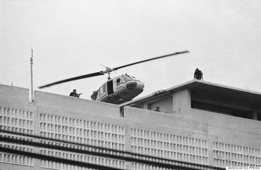 A U.S. Marine helicopter takes off from the American Embassy in Saigon on April 30, 1975. (AP Photo/Phu)