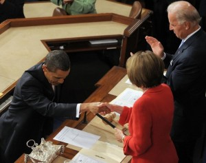 US President Barack Obama shakes hands with House Speaker Nancy Pelosi before Vice President Joe Biden prior to Obama's address on his embattled healthcare reform plan September 9, 2009 at the US Capitol in Washington, DC. Obama, whose approval ratings have taken a hit, hopes to regain control of healthcare reform, one of his top legislative priorities. AFP PHOTO / Saul LOEB (Photo credit should read SAUL LOEB/AFP/Getty Images)
