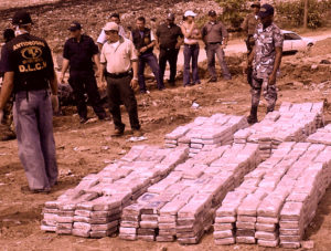 Roatan, HONDURAS:  Agents of the Direction of Fight against Narcotrafic of Honduras arrange two thousand Kilos of seized cocaine to be destroyed in Roatan, 08 November  2006. According to authorities Naval Forces seized the drugs shipment in Roatan, Islands of the Bahia in the Caribbean of Honduras 07 November. Twelve people four of them Colombians were arrested during the operation.   AFP PHOTO  (Photo credit should read STR/AFP/Getty Images)