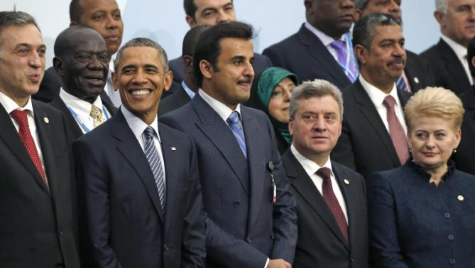 U.S. President Barack Obama, second left, and Brazil's President Dilma Rousseff, right, pose with world leaders for a group photo at the COP21, United Nations Climate Change Conference, in Le Bourget, outside Paris, Monday, Nov. 30, 2015. (AP Photo/Jacky Naegelen, Pool)