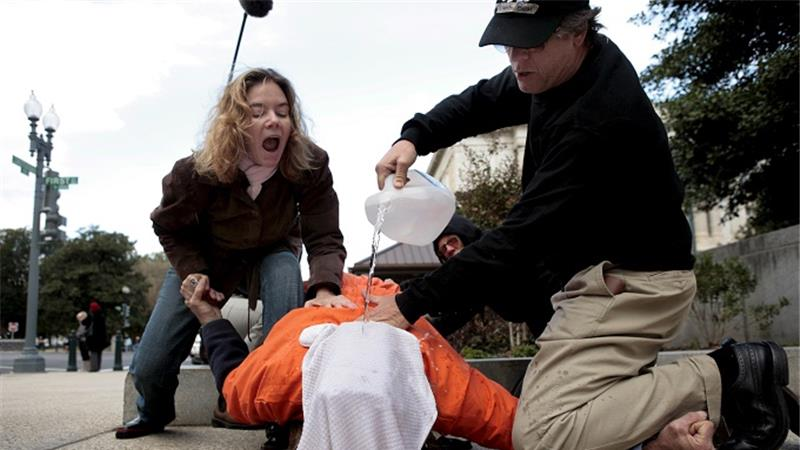 Human rights activists demonstrate waterboarding on a volunteer in Washington DC in 2007 [EPA].  If it was real torture, think anyone would actually 'volunteer'? class=