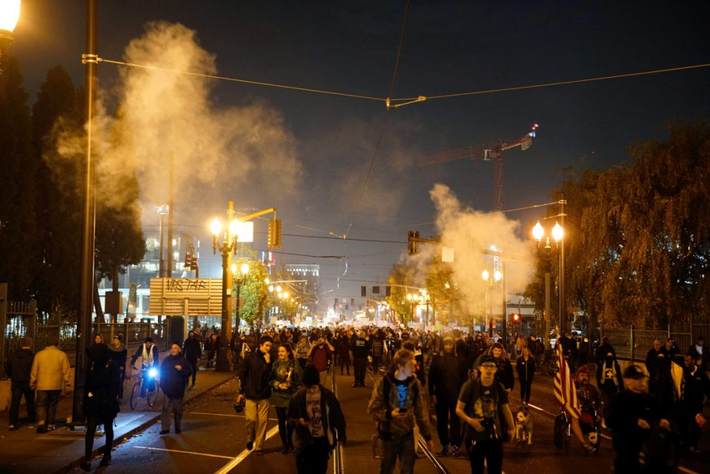 Smoke rises during a protest against the election of Republican Donald Trump as President of the United States in Portland, Oregon, U.S. November 10, 2016. REUTERS/William Gagan FOR EDITORIAL USE ONLY. NO RESALES. NO ARCHIVES - RTX2T63J